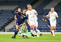 21st September 2021; Hampden Park, Glasgow, Scotland: FIFA Womens World Cup qualifying, Scotland versus Faroe Islands; Jane Ross of Scotland challenges Oluva Allansdottir Joensen of Faroe Islands for the ball