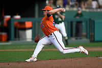 Starting pitcher Jacob Hennessy (32) of the Clemson Tigers delivers a pitch in a game against the William and Mary Tribe on February 16, 2018, at Doug Kingsmore Stadium in Clemson, South Carolina. Clemson won, 5-4 in 10 innings. (Tom Priddy/Four Seam Images)