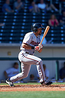 Surprise Saguaros right fielder LaMonte Wade (15), of the Minnesota Twins organization, follows through on his swing during a game against the Mesa Solar Sox on October 20, 2017 at Sloan Park in Mesa, Arizona. The Solar Sox walked-off the Saguaros 7-6.  (Zachary Lucy/Four Seam Images)