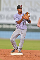 Kannapolis Intimidators shortstop Cleuluis Rondon #5 starts the turn on a double play during a game against the Asheville Tourists at McCormick Field on June 5, 2014 in Asheville, North Carolina. The Intimidators defeated the Tourists 5-3. (Tony Farlow/Four Seam Images)
