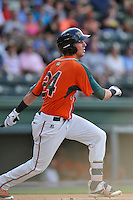 Center fielder Zach Sullivan (24) of the Greensboro Grasshoppers bats in a game against the Greenville Drive on Thursday, July 14, 2016, at Fluor Field at the West End in Greenville, South Carolina. (Tom Priddy/Four Seam Images)