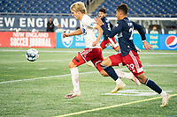 FOXBOROUGH, MA - OCTOBER 16: Nicolas Firmino #29 of New England Revolution pressures Thomas Roberts #23 of North Texas SC during a game between North Texas SC and New England Revolution II at Gillette Stadium on October 16, 2020 in Foxborough, Massachusetts.