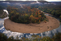 Once an ancient sea, its uplifted floor untouched by scouring glaciers that stopped to the north.  Eons of erosion carved deep valleys into the Ozarks crusty limestone plateau, transforming its flat surface into the unlikely role of hills.  They march nearly level into the distance, and peak at 2,600 feet in Arkansas's Boston Mountains...  Ozarks region in Missouri and Arkansas by Randy Olson for National Geographic Magazine.