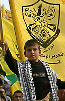 "Plaestinian child and Thousands of Palestinian Fatah supporters gather at a rally marking the third anniversary of the death of the late Palestinian leader Yasser Arafat in Gaza City, Monday, Nov. 12, 2007. Hamas security forces opened fire at a mass rally commemorating the death of the late Palestinian leader, violently dispersing the largest public display of support for the rival Fatah movement since Hamas seized control of the Gaza Strip in June. Five people were killed and at least 31 were wounded, medical officials and Fatah said.""photo by Fad Adwan"""