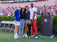 PASADENA, CA - AUGUST 4: Megan Rapinoe #15 poses with Kobe Bryant and his family during a game between Ireland and USWNT at Rose Bowl on August 3, 2019 in Pasadena, California.