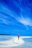 Man explores sandbar in the Aitutaki Lagoon, Aitutaki, Cook Islands