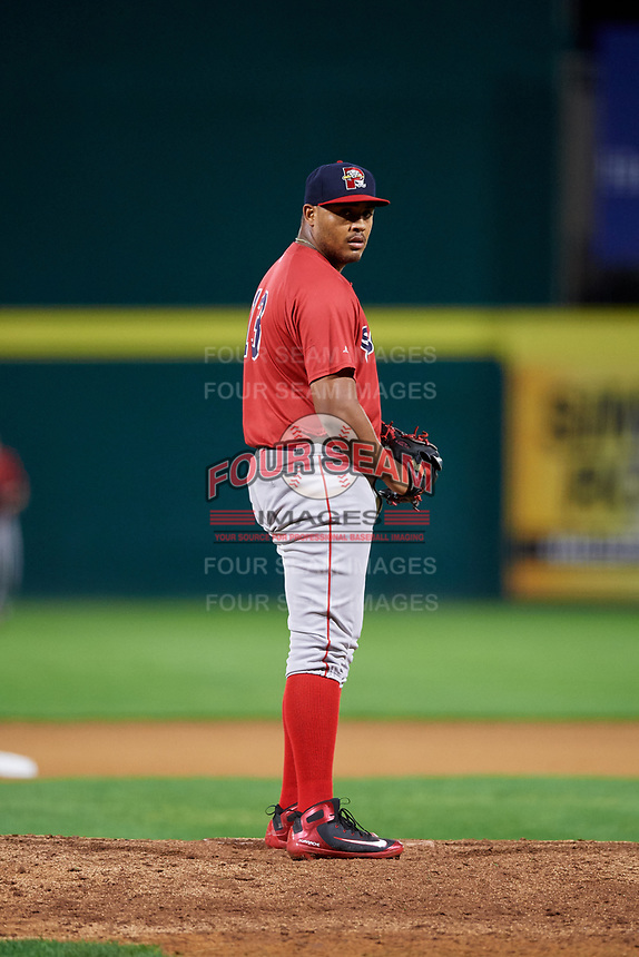 Portland Sea Dogs relief pitcher Darwinzon Hernandez (13) gets ready to deliver a pitch during a game against the Binghamton Rumble Ponies on August 31, 2018 at NYSEG Stadium in Binghamton, New York.  Portland defeated Binghamton 4-1.  (Mike Janes/Four Seam Images)