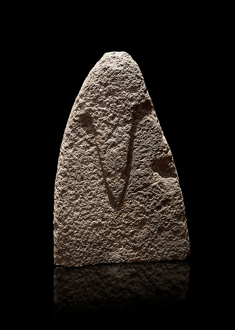 Top section of a Late European Neolithic prehistoric Menhir standing stone with carvings on its face side. The representation of a stylalised male figure starts at the top with a long nose from which 2 eyebrows arch around the top of the stone. Excavated from Amassed VII, Allai. Menhir Museum, Museo della Statuaria Prehistorica in Sardegna, Museum of Prehoistoric Sardinian Statues, Palazzo Aymerich, Laconi, Sardinia, Italy. Black background.