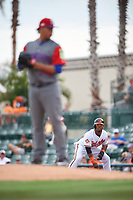 Baltimore Orioles Aneury Tavarez (57) leads off first base as pitcher Hansel Robles (74) gets ready to deliver a pitch during a Spring Training exhibition game against the Dominican Republic on March 7, 2017 at Ed Smith Stadium in Sarasota, Florida.  Baltimore defeated the Dominican Republic 5-4.  (Mike Janes/Four Seam Images)