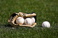 A glove filled with Rawlings Eastern League baseballs sits on the field at Dodd Stadium in Norwich, CT, Tuesday, June 3, 2008.