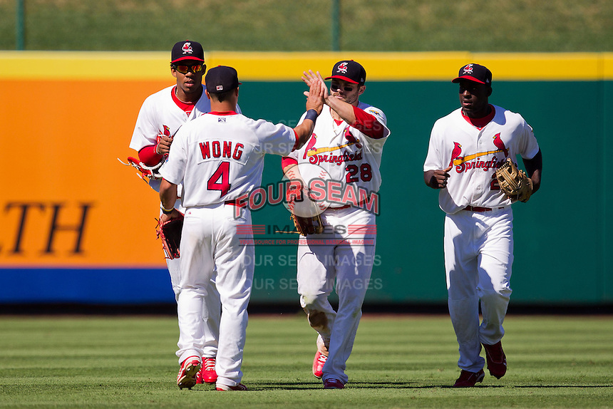Chris Swauger (28) of the Springfield Cardinals walks back tot he dugout with teammates after making a diving catch during a game against the Tulsa Drillers at Hammons Field on September 9, 2012 in Springfield, Missouri. (David Welker/Four Seam Images)