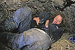 Kris Timmerman With Bear Cub In Den