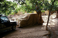 Protect by a sheet of parachute in autumn 2001, the English black Austin A135 Princess Vanden Plas Limousine is own now, by the Commander Idi Abdul Tarak in the Panshir Valley.