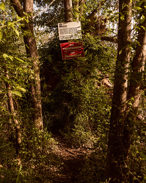 May 5, 2018. Riegelwood, North Carolina.<br /> <br /> Signs warn not to trespass on the property of the Cape Fear Public Utility Authority which serves the city of Wilmington.<br /> <br />  The water intake system of the city of Wilmington is located 50 miles downstream from the Chemours plant. The city is the largest city effected by the GenX contamination of the Cape Fear River. <br /> <br /> The Chemours Company, a spin off from DuPont, manufactures many chemicals at its plant in Fayetteville, NC. One of these, commonly referred to as GenX, is part of the process of teflon manufacturing. Chemours has been accused of dumping large quantities of GenX into the Cape Fear River and polluting the water supply of city's down river and allowing GenX to leak into local aquifers.