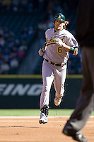 September 28, 2008: Oakland Athletics' Travis Buck trots around the bases after hooking a hard liner inside the right-field foul pole for a solo homer during a game against the Seattle Mariners at Safeco Field in Seattle, Washington.