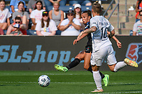 BRIDGEVIEW, IL - JULY 18: Mallory Pugh #9 of the Chicago Red Stars kicks the ball during a game between OL Reign and Chicago Red Stars at SeatGeek Stadium on July 18, 2021 in Bridgeview, Illinois.