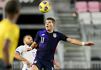 FORT LAUDERDALE, FL - DECEMBER 09: Chris Mueller #11 of the United States heads a ball during a game between El Salvador and USMNT at Inter Miami CF Stadium on December 09, 2020 in Fort Lauderdale, Florida.