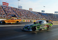 Jun. 30, 2012; Joliet, IL, USA: NHRA funny car driver Alexis DeJoria (near lane) races alongside teammate Jeff Arend during qualifying for the Route 66 Nationals at Route 66 Raceway. Mandatory Credit: Mark J. Rebilas-