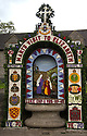 14/05/15<br /> <br /> Hand's Well.<br /> <br /> To mark ascension day this year's well dressings are unveiled and blessed by the local clergy in the Derbyshire village of Tissington in the Peak District National Park.<br /> <br /> Before today's blessings, wooden boards coated in clay are decorated with tens of thousands of petals, leaves and pieces of foliage to create the giant intricate mosaics. The boards,  take teams of many villagers three days to make. <br /> <br /> The village has been decorating its six wells every year for more than six hundred years. The tradition is believed to be a celebration of the wells never running dry, giving life and  sustaining the village during times of plague. After a church service today (Thursday)  clergy from six parish will bless each of the well.  <br /> <br /> Following in Tissington's footsteps many other villages in the Derbyshire area also have their own well dressing traditions.<br /> <br /> <br /> All Rights Reserved: F Stop Press Ltd. +44(0)1335 418629   www.fstoppress.com.