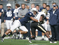 State College, PA - 10/15/2011:  Penn State CB D'Anton Lynn tackles Purdue WR Waynelle Gravesande.  Lynn completed 7 tackles during the game, his first back after suffering a head injury during the game against Indiana State.  Penn State defeated Purdue by a score of 23-18 on October 15, 2011, homecoming, at Beaver Stadium...Photo:  Joe Rokita / JoeRokita.com..Photo ©2011 Joe Rokita Photography