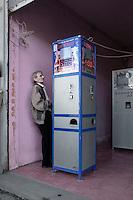 A man plays a slot machine in Batumi...