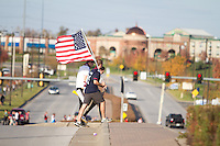 Fans of the United States Men's National Team walk across a street to enter Livestrong Sporting Park. United States played Guatemala at Livestrong Sporting Park in Kansas City, Kansas in a World Cup Qualifier on Tue. Oct. 16, 2012.