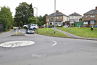Pictured: The scene of a car collision in which a white Dacia Duster was left balancing on top of a grey Suzuki in Newport, Wales, UK.<br />