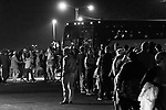 MIDDLETOWN, PA — SEPTEMBER 26, 2020:  Supporters of President Donald Trump wait in line to board shuttle buses at a rally during the Covid-19 pandemic at the Harrisburg International Airport on September 25, 2020 in Middletown, PA.  Thousands of attendees, most of whom were maskless, rode on shuttle busses to and from the long term parking lot and the event site— as the world nears one million Covid-19 deaths— defying the states ban on gatherings over 250 people.  Photograph by Michael Nagle