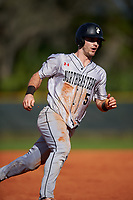 Northeastern Huskies right fielder Jeff Costello (5) running the bases during a game against the South Dakota State Jackrabbits on February 23, 2019 at North Charlotte Regional Park in Port Charlotte, Florida.  Northeastern defeated South Dakota State 12-9.  (Mike Janes/Four Seam Images)