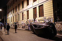 Pictured: A Mercedes car has been toppled over by protesters in the Exarchia district of central Athens Tuesday 02 December 2014<br />