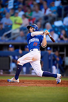 Tulsa Drillers shortstop Tim Locastro (15) follows through on a swing during a game against the Corpus Christi Hooks on June 3, 2017 at ONEOK Field in Tulsa, Oklahoma.  Corpus Christi defeated Tulsa 5-3.  (Mike Janes/Four Seam Images)