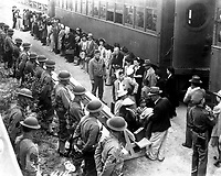 Persons of Japanese ancestry arrive at the Santa  Anita Assembly Center from San Pedro.  Evacuees lived at this center at the former Santa Anita race track before being moved inland to relocation centers.  Arcadia, CA, April 5, 1942.   Clem Alberts. (WRA)<br /> NARA FILE #:  210-G-3B-414<br /> WAR & CONFLICT #:  780