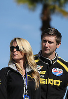 Mar. 17, 2013; Gainesville, FL, USA; NHRA top fuel dragster driver Morgan Lucas (right) with wife Katie Lucas during the Gatornationals at Auto-Plus Raceway at Gainesville. Mandatory Credit: Mark J. Rebilas-