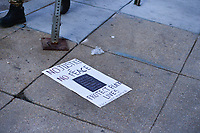 Washington, DC - May 31, 2020: a sign litters the ground as  protesters gather in Lafayette Park across from the White House May 31, 2020 following the death of George Floyd in Minneapolis.  (Photo by Don Baxter/Media Images International)