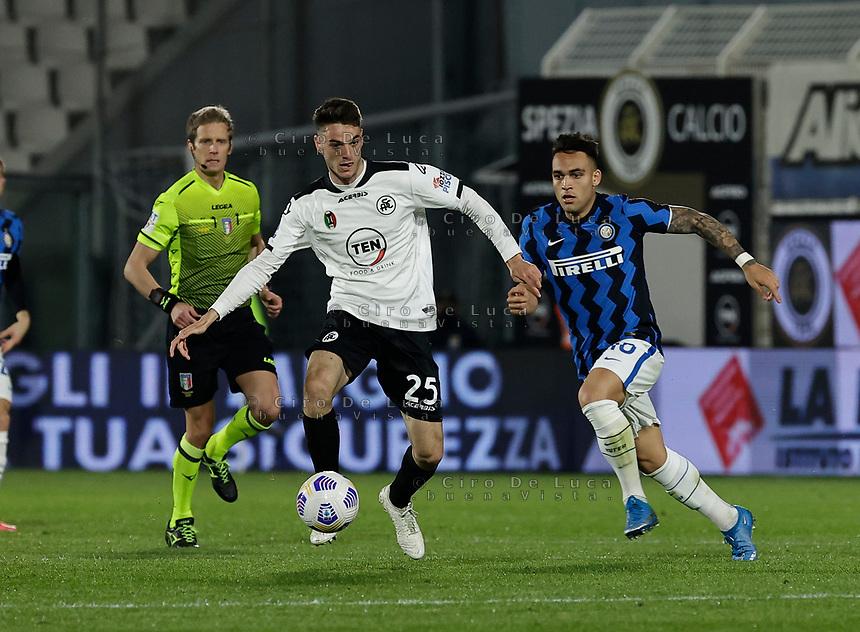 Giulio Maggiore  and Lautaro Martinez of Inter  during the  italian serie a soccer match,Spezia Inter Milan at  the STadio Picco in La Spezia Italy ,