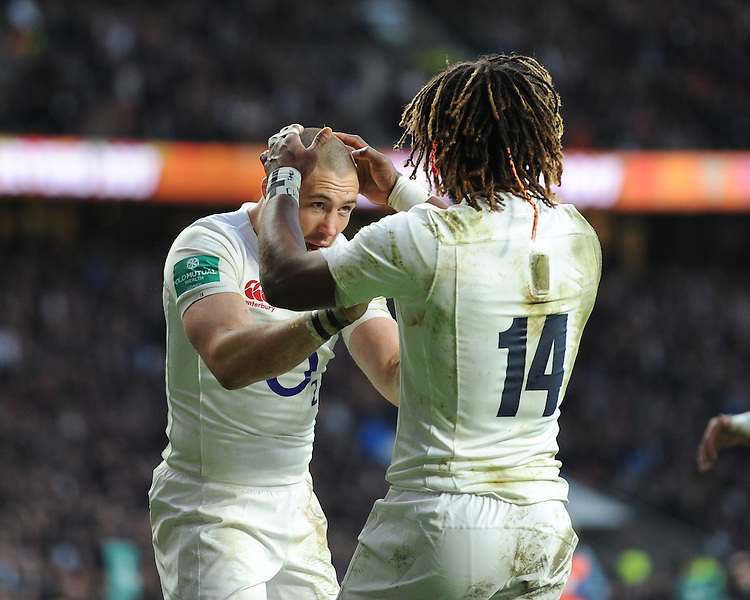 Marland Yarde of England is congratulated by Mike Brown of England after scoring a try during the Old Mutual Wealth Series match between England and Australia at Twickenham Stadium on Saturday 3rd December 2016 (Photo by Rob Munro)