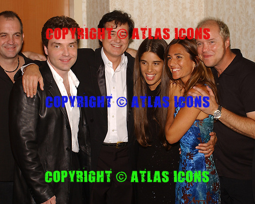 FORT LAUDERDALE FL - MAY 08: Richard Marx, Jimmy Page and his wife Jimena Gomez-Paratcha Page attend the Brazilian children's charity event held at the Fort Lauderdale Marriott on May 8, 2002 in Fort Lauderdale, Florida. : Credit Larry Marano © 2002