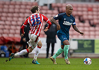 20th March 2021; Bet365 Stadium, Stoke, Staffordshire, England; English Football League Championship Football, Stoke City versus Derby County; Andre Wisdom of Derby County under pressure from Nick Powell of Stoke City