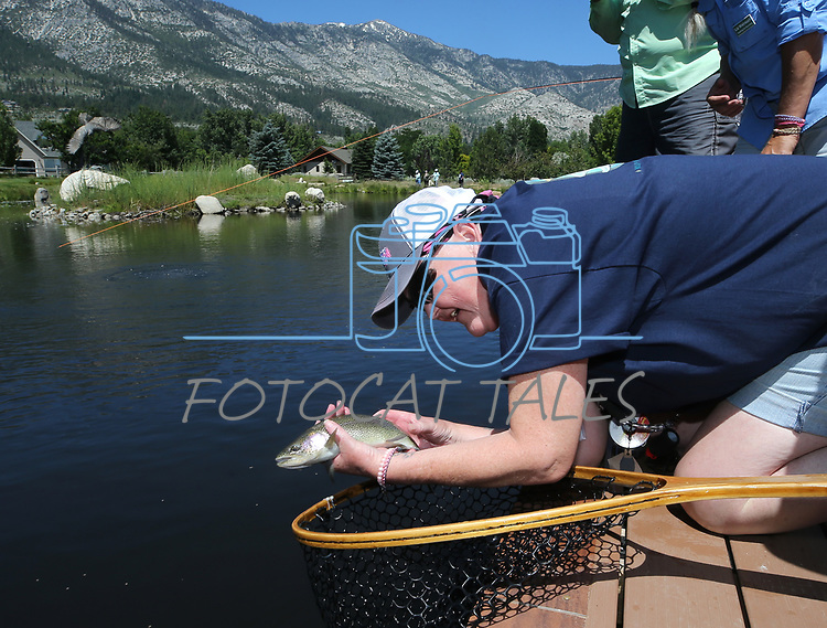 Breast cancer survivor Jinnie Ziemer releases her catch during a Casting for Recovery retreat in Gardnerville, Nev., on Friday, June 30, 2017. <br /> Photo by Cathleen Allison/Nevada Photo Source