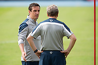 Gary Neville talks to England manager Roy Hodgson