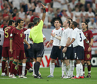 English forward (9) Wayne Rooney is given a red card by referee Horacio Elizondo.  Portugal defeated England on penalty kicks after playing to a 0-0 tie in regulation in their FIFA World Cup quarterfinal match in Gelsenkirchen, Germany, July 1, 2006.