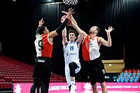 06-03-2021: Basketbal: Donar Groningen v ZZ Feyenoord: Groningen Donar speler Willem Brandwijk tussen Feyenoord speler Juan Davis en Feyenoord speler Jeroen van der List