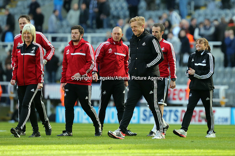 Pictured: Swansea head coach Garry Monk takes to the pitch after the final whistle. Saturday 19 April 2014<br /> Re: Barclay's Premier League, Newcastle United v Swansea City FC at St James Park, Newcastle, UK.