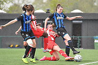 Davinia Vanmechelen (25) of Standard   pictured fighting for the ball with Nicky Van Den Abbeele (28) of Club Brugge during a female soccer game between Club Brugge Dames YLA and Standard Femine de Liege on the seventh matchday in Play-Off 1 of the 2020 - 2021 season of Belgian Scooore Womens Super League , saturday 15 May 2021  in Brugge , Belgium . PHOTO SPORTPIX.BE | SPP | DAVID CATRY