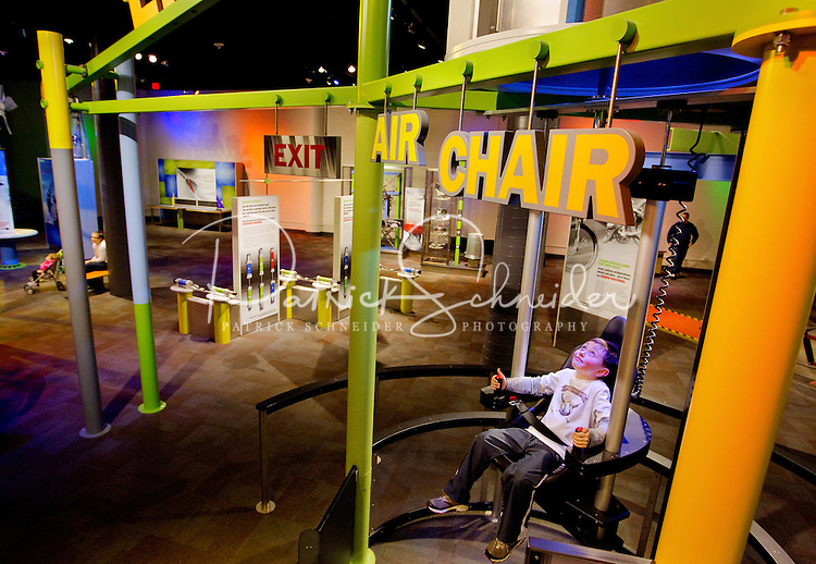 "Charlotte, NC on-location photography of Discovery Place, Charlotte's hands-on science museum located in downtown Charlotte NC. This image was taken in the museum's ""Cool Stuff"" area, where visitors can launch objects into the air, lie on a bed of nails and uncover the wonders of science with hands-on exploration of multi-dimensional exhibits."