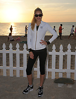 Orig Pix Taken 2004 in Florida<br /> <br /> MIAMI BEACH, FL - MAY 23: It looks like 'The Biggest Loser' might have found another new trainer. According to reports, tennis star Anna Kournikova will join the NBC fitness show next season.<br /> <br /> Kournikova will join new trainers Cara Castronuova and Brett Hoebel as the show undergoes major changes in the wake of Jillian Michaels' departure from the hit show, X17 Online reports. Michaels announced her decision to leave last year in order to focus on starting a family.<br /> <br /> An official announcement regarding Kournikova's role on 'Biggest Loser' is expected after the show's season finale on Tuesday.<br /> <br /> Kournikova, who recently put her $9.4 million Miami mansion on the market, is certainly no stranger in the fitness world. A tennis player all her life, she debuted at the U.S. Open when she was just 15 years old and was named ESPN's Hottest Female Athlete in 2002.<br /> <br /> The tennis star has been dating singer Enrique Igelsias since late 2001.   on May 22, 2011 in Miami Beach, Florida<br /> <br /> <br /> People:  Anna Kournikova