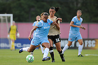 Rosana (11) of Sky Blue FC is defended by Greer Barnes (14) of FC Gold Pride. Sky Blue FC defeated FC Gold Pride 2-0 during a Women's Professional Soccer match at Yurcak Field in Piscataway, NJ, on August 05, 2009.