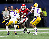 ATLANTA, GA - DECEMBER 7: Kary Vincent Jr. #5 and Patrick Queen #8 of the LSU Tigers stop a run by Brian Herrien #35 of the Georgia Bulldogs during a game between Georgia Bulldogs and LSU Tigers at Mercedes Benz Stadium on December 7, 2019 in Atlanta, Georgia.