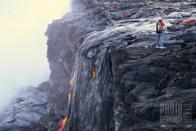 Spectator watches as new lava flows from Kilauea volcano, Hawaii volcanoes national park, Big Island