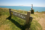 Beachy Head - one of the UK's most famous landmarks the cliff face at Beachy Head on the South Downs is also notorious as a suicide spot. Warning signs and flower memorials are on the cliff edge.